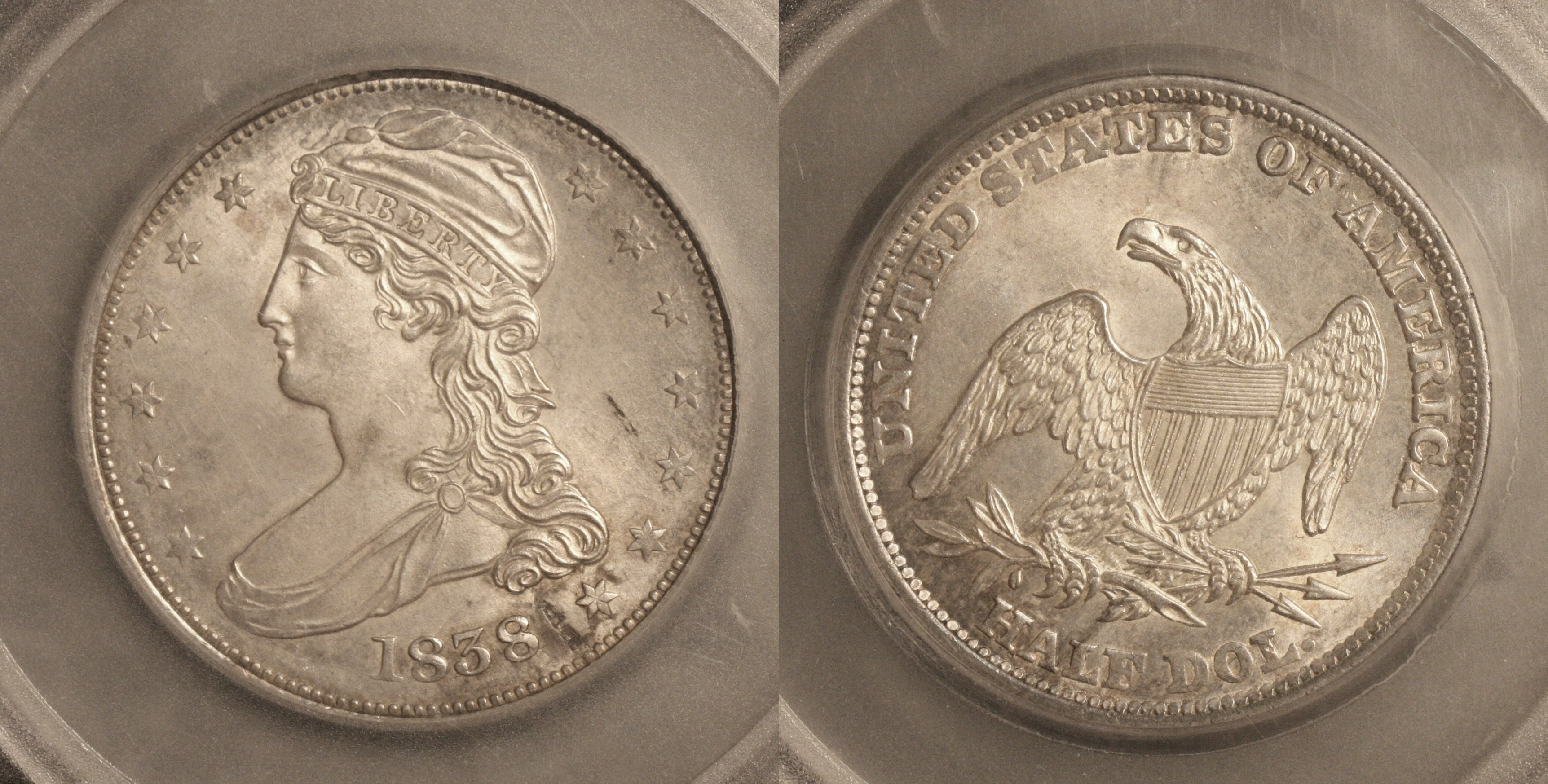1838 Reeded Edge Capped Bust Half Dollar SEGS MS-63 camera