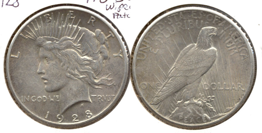 1928 Peace Silver Dollar AU-55 Wiped Patch